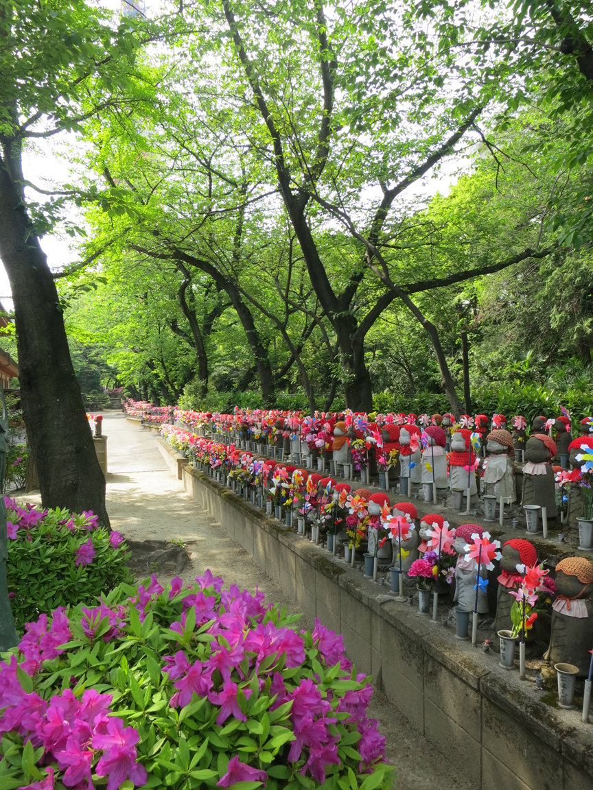 There are hundreds of Jizo figures at Zojoji, and its especially beautiful in the spring.