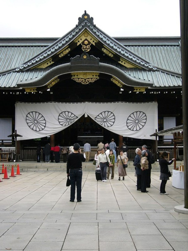 The sanctuary at the Yasukuni shrine is built of plain cedar, with gold fittings.