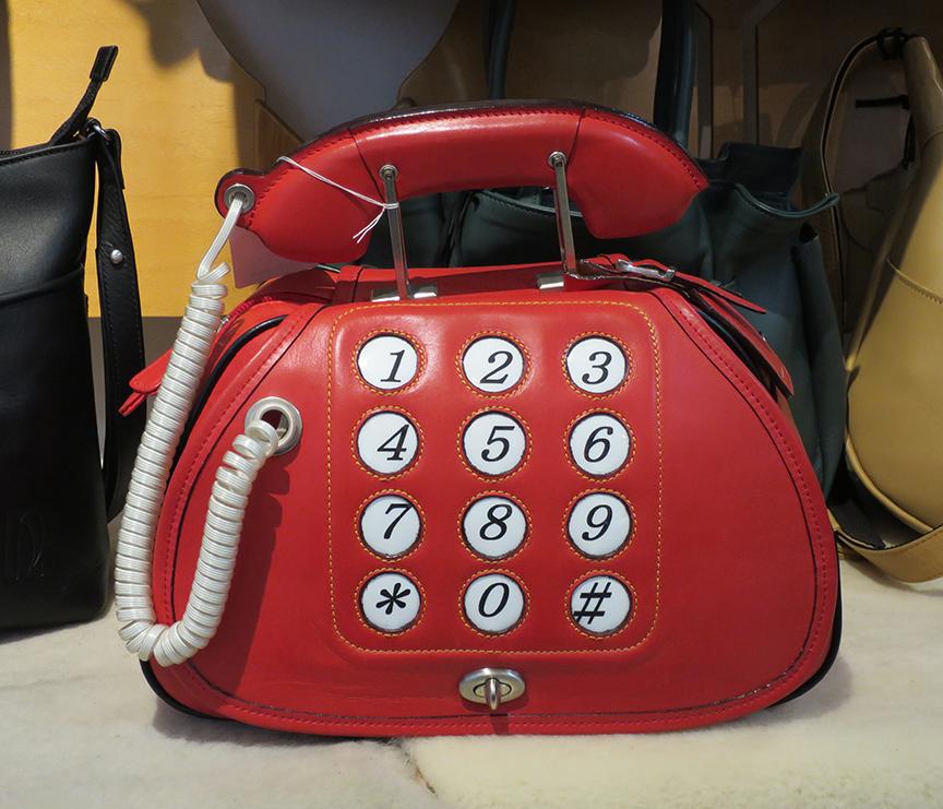 This leather goods shop sells wonderful regular purses as well as one that look like telephones and slices of watermelon.