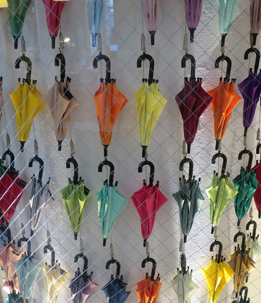 You can order a custom-made umbrella from this shop, in many sizes, colors and patterns.