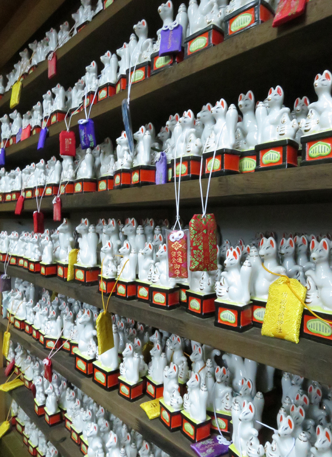 This shrine is well known as a power spot, as you can see by the number of fox figures offered here.