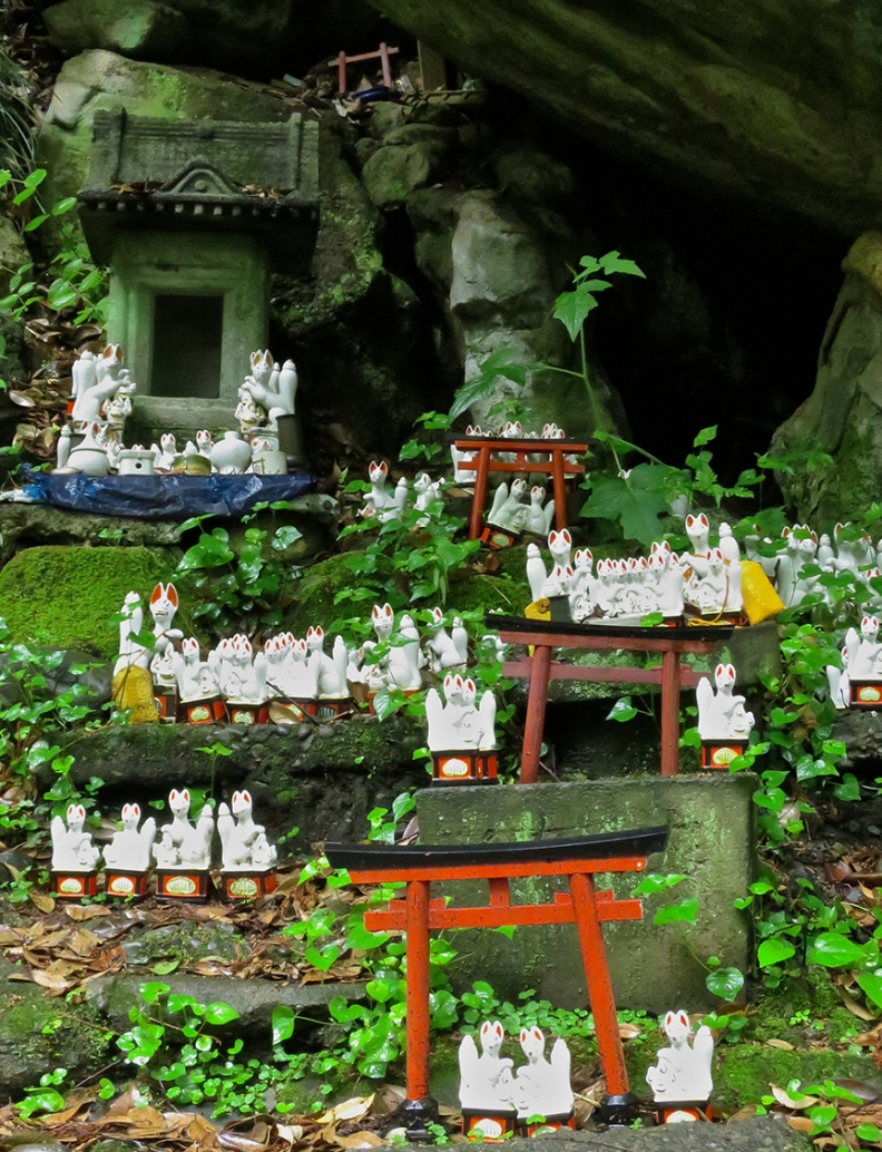 As you climb the path to the various sub-shrines, you pass little villages populated by lucky fox figures left there by pilgrims.