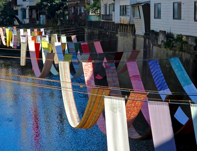 Kimono fabric draped along canal in Nakai at some-no-komichi festival
