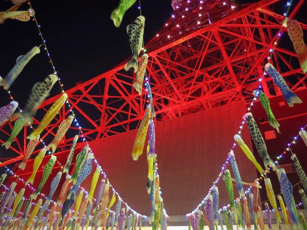 Koi nobori fish flags flying at Tokyo tower at night