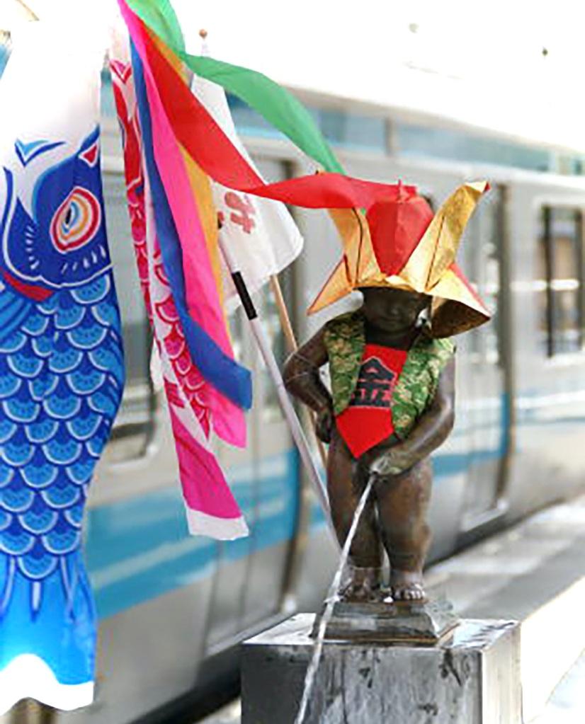 Koi nobori fish flags at the peeing statue on the platform at Hamamatsucho station