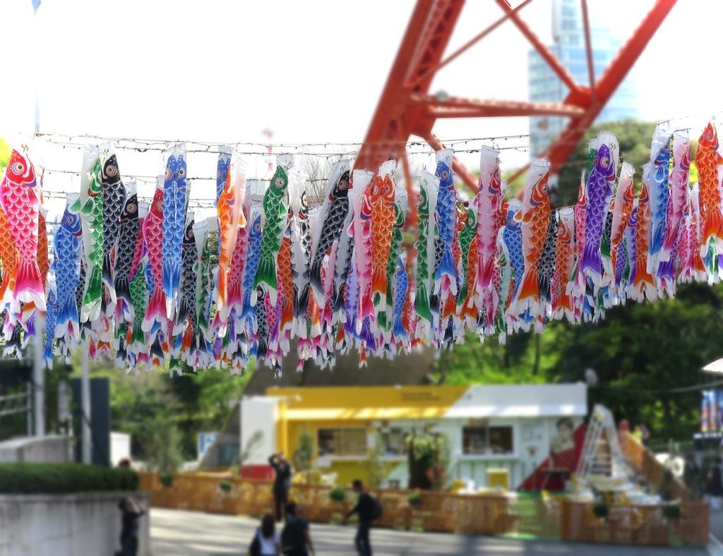 Big display of koi nobori fish flags flying at Tokyo Tower