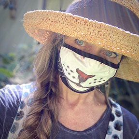 Author Jonelle Patrick in cat face mask