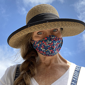 Author Jonelle Patrick in flowered mask