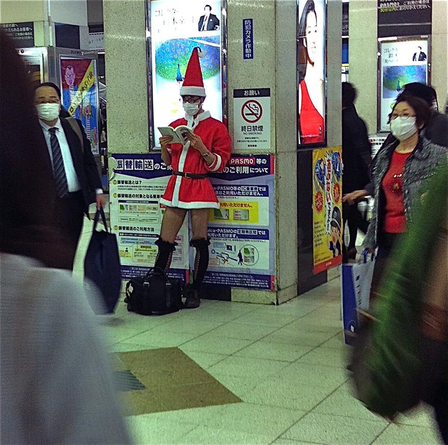 Man dressed as sexy Santa in Shibuya station
